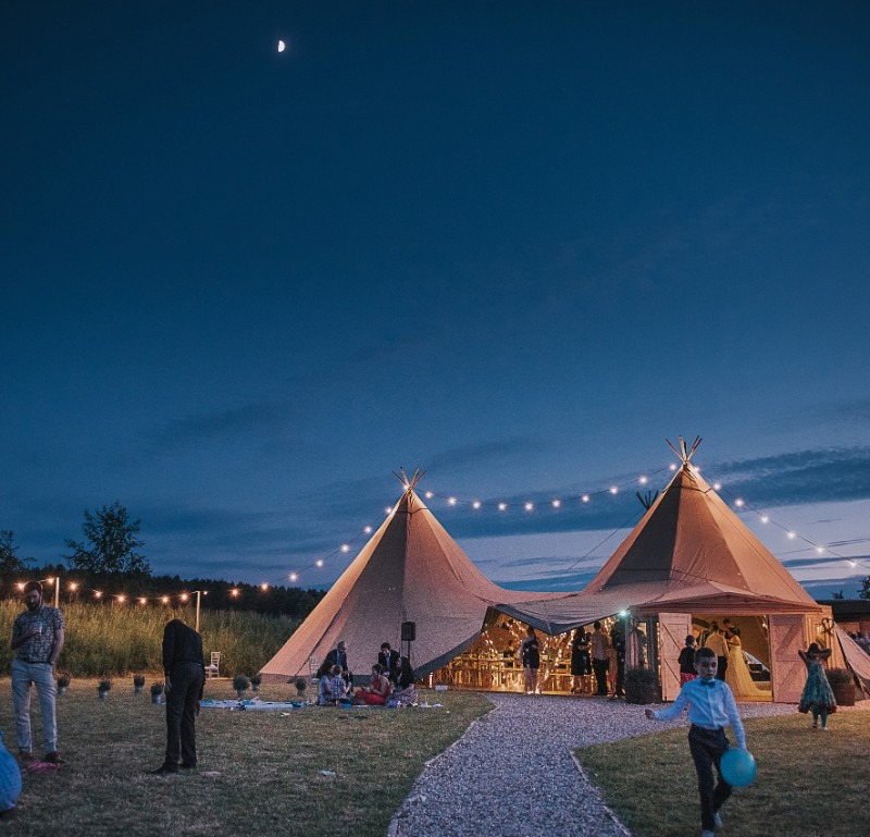 beautifully lit tipis with festoon lighting at a wedding cotswold tipis. Black Bedroom Furniture Sets. Home Design Ideas
